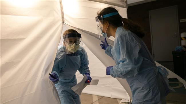 US health workers say grappling with lack of protective equipment amid fight with coronavirus